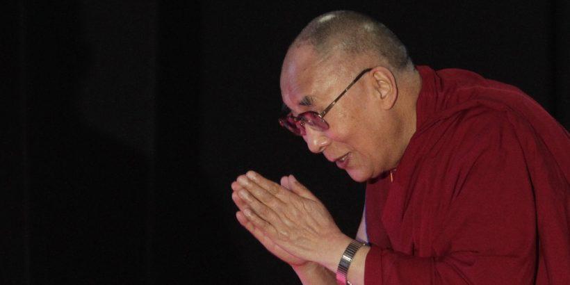 "Tibetan spiritual leader the Dalai Lama greets the audience as he arrives to speak on ""A Human Approach to World Peace"" at Presidency College in Kolkata, India, Tuesday, Jan. 13, 2015. (AP Photo/Bikas Das)"
